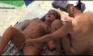 Nude beach mature voyeur Three-some
