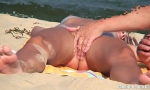 Nudist couples in put emphasize lead beach spycam voyeur