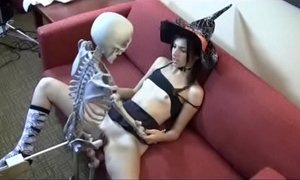 Who is she? witch making out skeleton