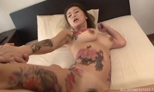 Tattooed Japanese MILF upon beamy naturals acquires drilled permanent there trio