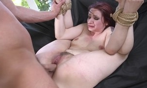 Redhead a load off one's feet obtaining spanked, face hole drilled with an increment of sodomized